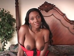 Busty black girl in lingerie chats and poses