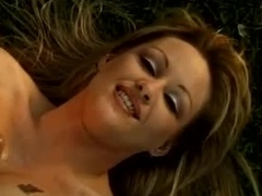 Blond with big knockers doing tit fuck outdoors